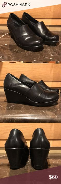 Dansko Rosaline Burnished Nappa Black Shoe Sz 11 Size: 41 or US 11. Color: Black. An ergonomically designed memory-foam insole adds signature comfort to a suave, professional-grade wedge pump.  This product contains:  – Round toe – Topstitching – Dual side goring – Slip-on – Wedge heel – Approx. 2.75″ heel, 0.5″ platform – Leather upper Dansko Shoes