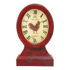 Red weathered table clock with a hen motif.