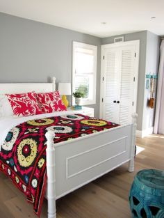 wall color is Forever Platinum by Dunn-Edwards. Love the suzani bedspread too