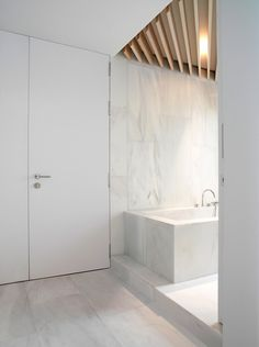 Orfila Flat by Schneider Colao  softwood beam created the ribber ceiling in the bathroom