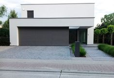 Front yard is very important. You can decorate your front yard with flowers, grass, rocks and a lot of other. Having a small front yard doesn Modern Landscape Design, Modern Landscaping, Front Yard Landscaping, Landscaping Ideas, Building A Fence, Home Building Design, Cheap Garage Doors, Future House, Modern Architecture