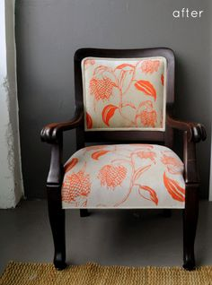 Wonderful chair and print-I love the contrast of the bright orange against the dark, classic wood