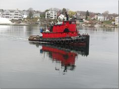 I love seeing tugboats on the Piscataqua River in downtown Portsmouth N - this is a visiting tug helping with the work going on on the Memorial Bridge.  Love the reflection on the water!