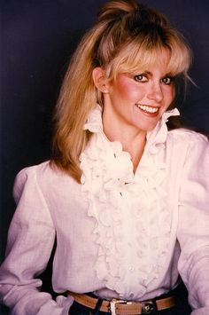 Olivia Newton-John is an English born Australian singer and actress. Her first hit in the US was the Bob Dylan penned If Not For You, since then she's won five Grammy Awards and has starred in several movies including Xanadu and Grease.