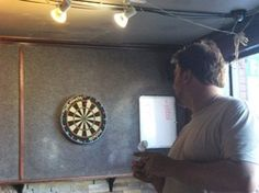 Here are tips to help you aim a dart and improve your darts game. Play Darts, Darts Game, Man Cave Room, Man Cave Bar, Dart Board Games, Garage Playroom, Design Your Bedroom, Gamer Room, Boredom Busters