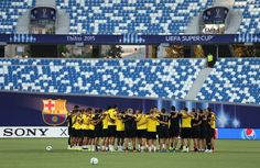 Sevilla FC huddle together during a training session ahead of the UEFA Super Cup match between Barcelona and Sevilla FC at Dinamo Stadium on August 10, 2015 in Tbilisi, Georgia.