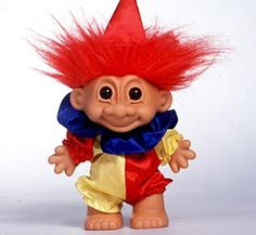 "Troll Doll, 1959. ""With their wrinkled faces, gravity-defying hair and mischievous grins, these small plastic dolls have experienced several spurts of popularity, in the '60s, '70s, '80s and '90s."""