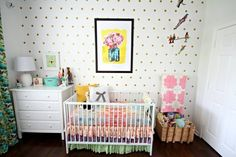 a bright, eclectic nursery with a lot of color
