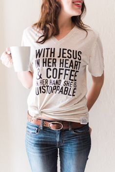 """Super soft oatmeal unisex v neck t-shirt with our """"With Jesus in her heart and coffee in her hand she is unstoppable"""" design. www.karlastorey.com"""