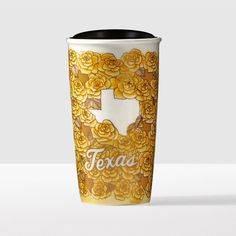 "Texas Double Wall Traveler. A double-walled mug with a yellow rose pattern and a center ""dot"" in the shape of Texas."