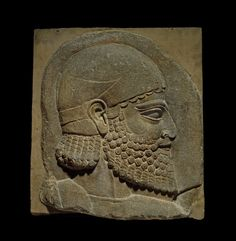 Gypsum wall-panel depicting a bearded man in relief. Reign of Sargon II. Neo-Assyrian. 710 - 705 B.C. | The British Museum