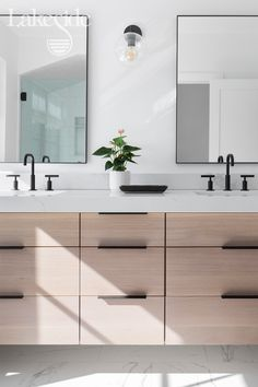 The natural wood cabinets mixed with the white countertop and walls makes this bathroom a relaxing oasis. Wood Bathroom Cabinets, Bathroom Renos, Wood Cabinets, Washroom, Bathroom Photos, Modern Bathroom, Master Bathroom, White Countertops, New Home Construction