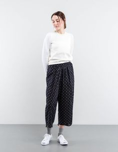 Millard trouser from Isabel Marant Étoile. Made from soft, lightweight cotton and finished with beige polka dots. The trousers feature a loose silhouette, comfortable elasticised waistband and two side slit pockets.    Black 100% Cotton  Worn here with sweater from Comme des Garçons Comme des Garçons and trainers from Converse. Jewelry is by Anni Lu, Laura Lee and Pernille Corydon.  Isabel Marant products are available in-store only. Please contact : (+46) 08 - 658 2441 or email…
