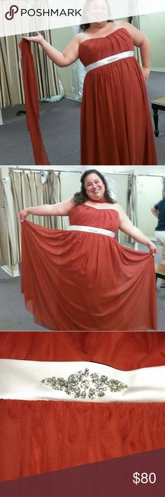 ❣️HP❣️Plus Size Prom/Bridesmaid Gown!!! Everything Plus Size HP THIS WEEK!!! Floor length flowing layers. Strapless with empire waistline. Comes with matching shawl. The official color is 'cinnamon' which is a deep burnt orange. Decorated with fixed ivory and rhinstone sash. There's a snagged thread several inches below the sash on the outer layer (see pic 4). Otherwise great condition. Might be slightly wrinkled from being packaged. Can be dry cleaned or hand washed. Altered to fit size…