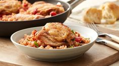Italian Chicken and Rice Skillet Chicken and rice are classic partners, and in this version they get an Italian twist. Chicken thighs are cooked with a flavorful tomato-based rice, spiked with fresh basil. It's all done in one skillet for easy cleanup! Italian Chicken Recipes, Turkey Recipes, Dinner Recipes, Dinner Ideas, Healthy Food List, Healthy Recipes, Easy Recipes, Paleo, Skillet Meals