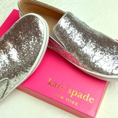 Kate Spade Silver Glitter Sneakers NWT Sparkly Silver Slip-On Sneakers.  New with box. Tried on in store only. Perfect for the holidays! kate spade Shoes
