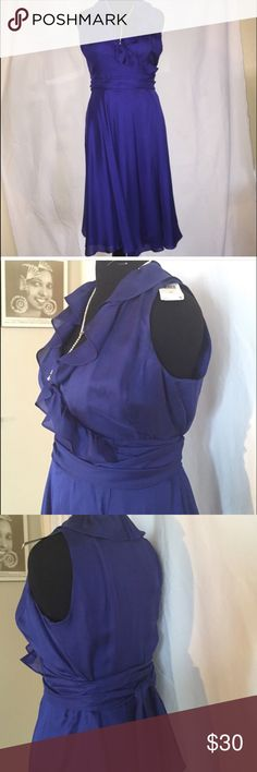 """Wrap Yourself in Pretty Purple Beautiful flowing wrap dress. Rich jewel toned sapphire color. Long sash can be double wrapped or let hang down. Shell 100% silk, lining acetate. Size 12 displayed on dress form dimensions (39-31-41). Fall is 28"""" from waist. Ralph Lauren Dresses"""