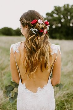 Flowers tucked into half-up bridal hair and loose curls | Melissa Green Photography