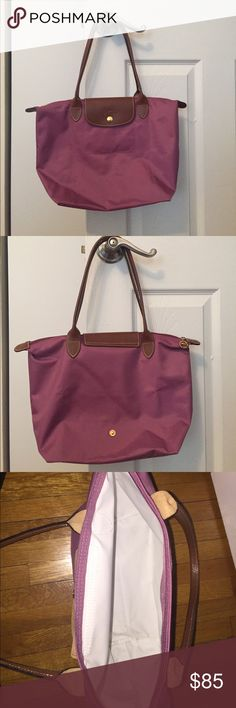 Longchamp Le Pliage 2605 in Purple Longchamp Le Pliage medium sized light purple bag in excellent condition. This bag has barely been used! Longchamp Bags Totes