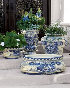 Beautiful blue and white planters, but they are made of fibreglass.  Genius! Neiman Marcus.