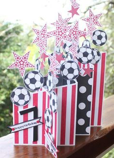 handmade birthday card ... from Heather's mom for her grandson ... age 7 ... red, white and black ... stamped and punched soccer balls and stars galore ... looks to be a double cascade card format ... awesome!!!