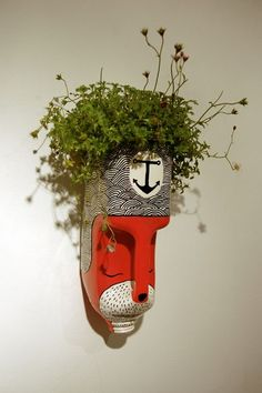 HEAD GARDNER  /  A guerilla gardening project, turning milk bottles into characters and planting them around the city. by Anna Garforth