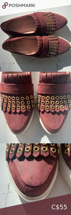 Kate Spade Courtney Grommet Slip On Sneaker So cute & perfect for fall!! These Kate Spade Courtney Grommet Slip On Sneakers feature goatskin leather, a rich maroon colour and gold grommet details on the kilter fringe. Shoes have signs of wear with some marks on the leather on the toes, some small scuffs on the heels & toes - see pics for closeups. Overall in good condition. - stock photo from shopbop kate spade Shoes Sneakers Metallic Sneakers, Slip On Sneakers, Shoes Sneakers, Maroon Colour, Kate Spade Keds, Glitter Shoes, Top Shoes, White Leather, Signs