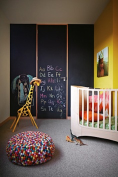 Rainbow kid's room/ nursery with chalkboard walls. Love the felt ball ottoman