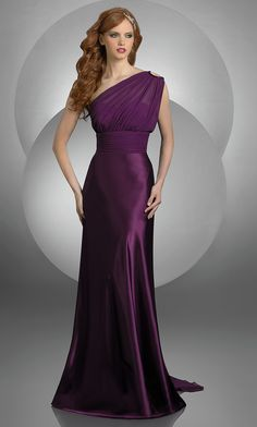 Look like you just stepped off the red carpet in this slinky purple one shoulder prom dress by Bari Jay. This elegant long evening gown for prom or party features a fashion forward keyhole opening at the one shoulder strap. Sheer draping sweeps up from the empire waist, over the shoulder and cascades down the back to create a sweep train. $218.00