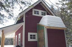 Asphalt shingles vs steel roof. Look at the snow build up on the asphalt roofed shed.