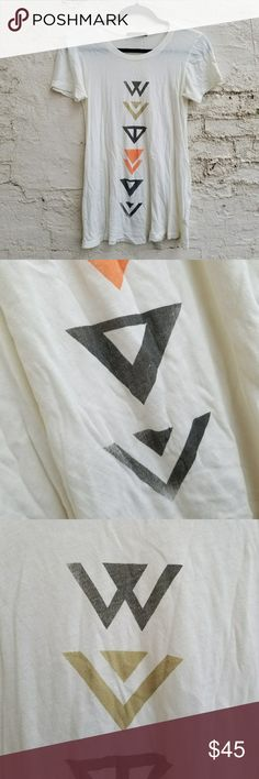 """{Wildfox} 2008 Tribal Arrows swing tee. SEE MEASUREMENTS.  Classic, old-school Wildfox design from 2008, right after the company changed their name from Whitehorse.  100% cotton tissue tee, semi-sheer. All distressing at collar, sleeves, and hems hand-done at the factory. Graphic fade by design. Warm ivory, not white. Excellent vintage condition. No flaws, just wrinkled from storage. Feminine A-line shape, longer length.  TAGGED XS, RUNS TRUE TO SIZE.  WOULD FIT XXS-SLIM SMALL. LENGTH: 26""""…"""