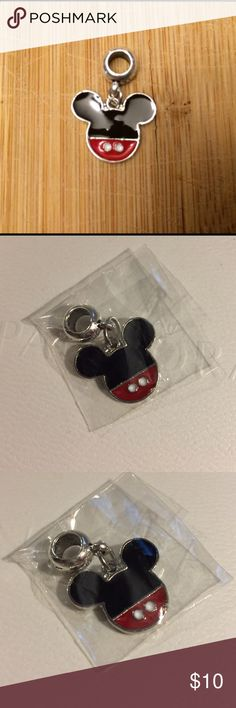 New Disney Mickey Mouse Dangle Charm 925 Silver New 925 Sterling silver Dangle charm bead made specifically for Pandora bracelets. Charm itself is not Pandora, it just fits Pandora and still made in high quality 925 Sterling Silver material. It would make a great addition to your Pandora bracelet. Be sure to check out other charms available for sale to bundle and save big! Pandora Jewelry Bracelets