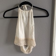 Brandy Melville Halter Beautiful cropped Brandy Melville halter in a cream color with lace at the bottom. Easy and effortless summer shirt and super cute from the back. Brandy Melville Tops