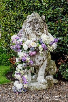 Decorated lions at Goldsborough Hall. Flowers by Horticouture, image by Dominic Wright Photography