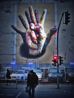 """Street art by Case - """"Unter Der Hand"""" in Berlin."""