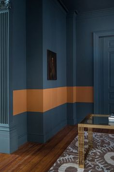 Explore stunning interior paint and wallpaper design inspirations from Paint & Paper Library. Like this feature wall of dark blue paint with an orange stripe. Colour Blocking Interior, Color Blocking, Paint And Paper Library, Wallpaper Wall, Mad About The House, Block Painting, Paint Color Schemes, Paint Colors, Striped Walls