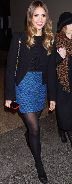 Who made  Jessica Alba's black jacket, blue skirt, black shoes, and top that she wore in New York?