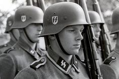 These are young Latvian Waffen-SS volunteer legionnaires. The Latvian Legion was a formation of the Waffen-SS during World War II created in 1943 which consisted primarily of ethnic Latvian conscripts. The 19th Latvian Division held out in the Kurland Pocket in western Latvia along the Baltic Gulf of Riga until May 10, 1945, when it was among the last German battle groups to surrender in Europe.