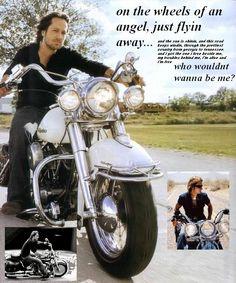 KU on his bike on the wheels of an angel.