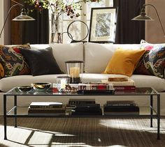 No iron and glass coffee tables but I like the set up of couch, table, lights, pillows