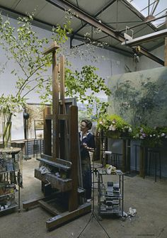 Claire Basler home and studio on the outskirts of Paris. Large scale floral panels and the plants that inspire them