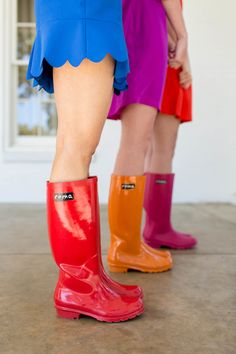 Boots Provided by Roma Boots, a one for one company that uses fashion to  give poverty the boot. Boots shown in Glossy Red, Glossy Orange, and Matte  Magenta.