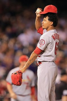 Relief pitcher Carlos Martinez looks on as he gives up four runs against the Colorado Rockies in the seventh inning.. Cards won the game 11-4.  9-17-13