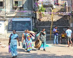Workers near the Banganga Lake, Malabar Hill, Mumbai, India