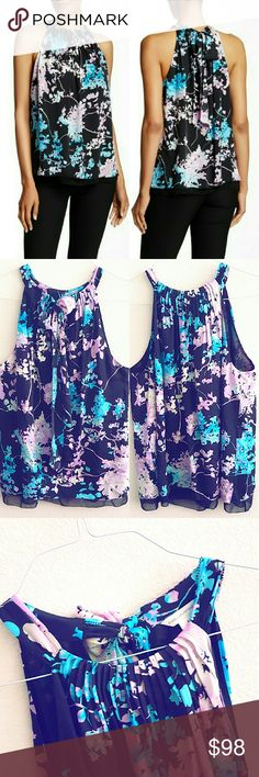 """DVF Lexi Halter Top A pleated neckline draws the eye, on a floral top with a draped tie detail at the back. - Halter neck - Sleeveless - Split back with tie closure - Lined - Approx. 27"""" length Shell: 97% silk, 3% spandex. Lining : 100% polyester.  Only worn couple times, in excellent condition. Diane von Furstenberg Tops Blouses"""