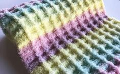 Made with soft bulky yarn and a sweet rainbow color scheme, this Rainbow Waffle Crochet Baby Afghan Pattern is sure to make everyone smile! Baby Afghan Crochet Patterns, Crochet Baby Blanket Beginner, Baby Patterns, Beginner Crochet, Stitch Patterns, Crochet Waffle Stitch, Crochet Crowd, Waffle Blanket, Blanket Yarn
