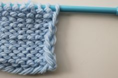 Knitting 911: How to Neaten Up a Sloppy Knit Edge Stitch.  Chain edge on wrong side of knitting