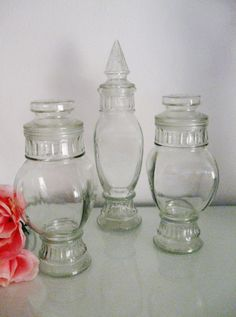 This is a fantastic trio of vintage glass jars. They are from the 40s loaded with character! The height allows for them to be great display