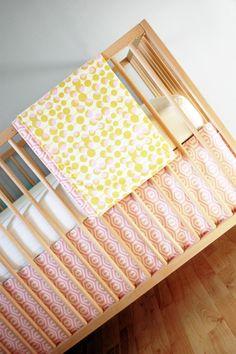 crib set. pink and mustard. $94.00, via Etsy.