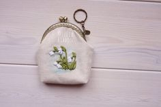 A personal favourite from my Etsy shop https://www.etsy.com/listing/526030367/snowdrops-coin-purse-snowdrops-purse